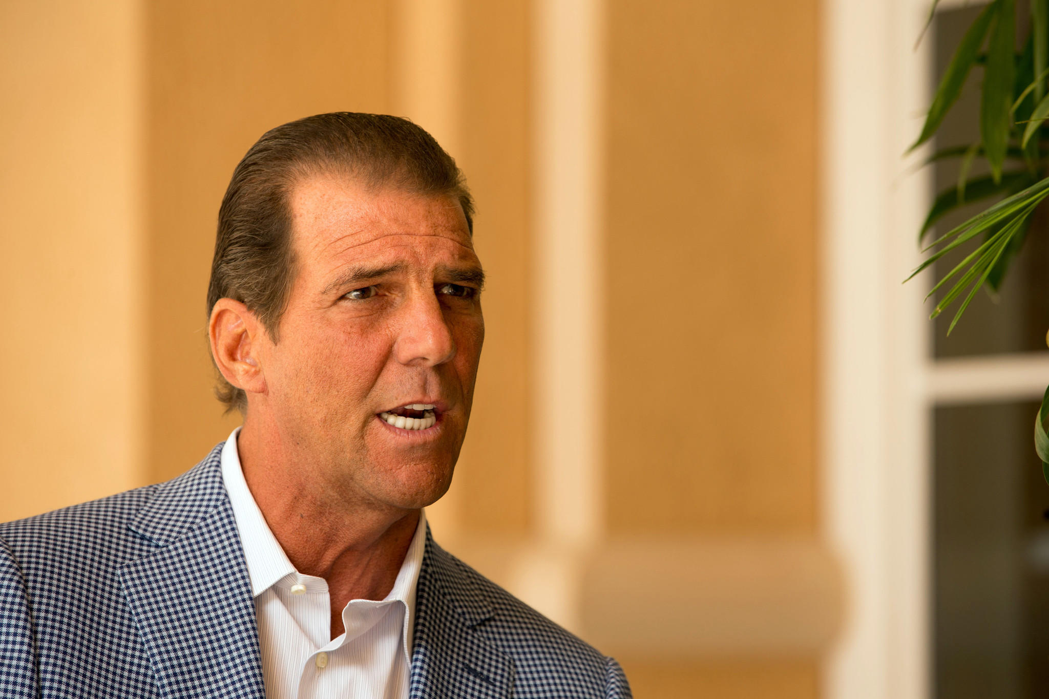 Baltimore Ravens owner Steve Bisciotti answers questions during an interview at the NFL Annual Meetings.