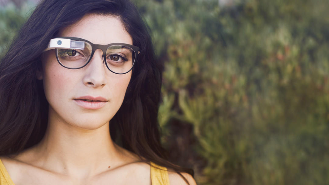 Google said it has begun working with eyewear company Luxottica to create Ray-Ban and Oakley versions of its Glass wearable device.