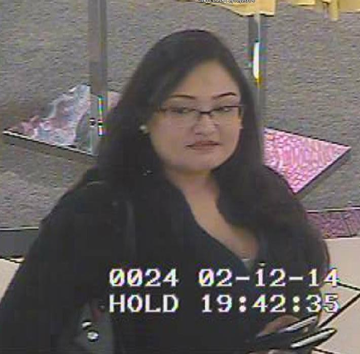 Surveillance photo of woman who police are seeking in connection with alleged thefts using credit accounts created with another person's identity.