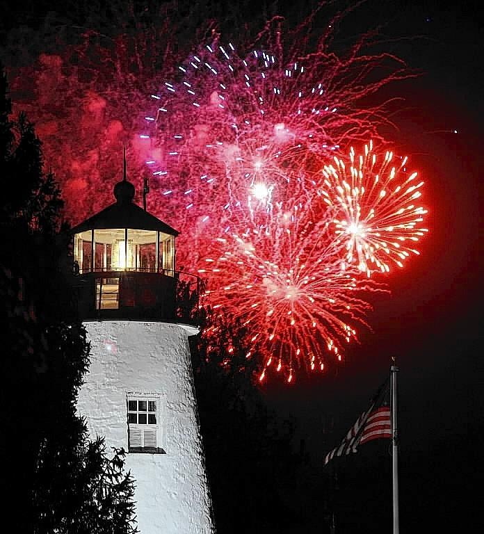 "Havre de Grace is among Smithsonian Magazine's ""The 20 Best Small Towns to Visit 2014"" and is the first Maryland town named in the list's three years of publication. Pictured above is the city's historic Concord Point Lighthouse during the fireworks that capped the War of 1812 Bicentennial celebration in May 2013."