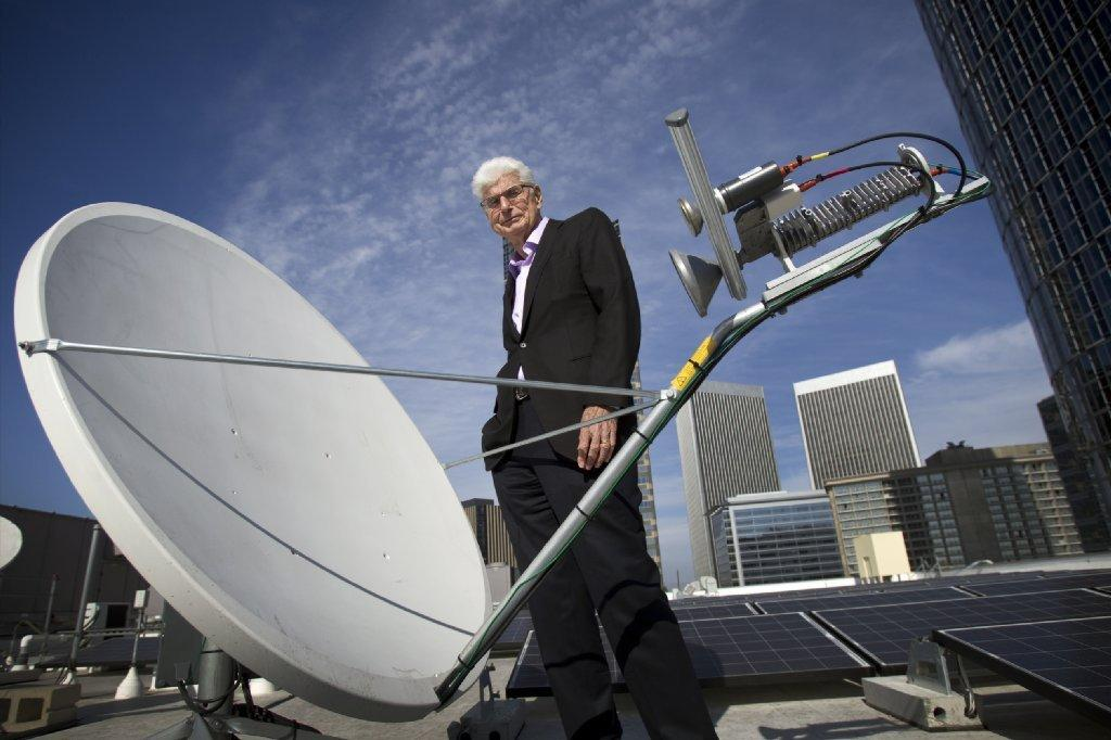 Randy Blotky, CEO of the Digital Cinema Distribution Coalition, stands by a satellite dish on the roof at the AMC Century City 15 theater. The satellite network significantly reduces the price of showing movies in theaters.