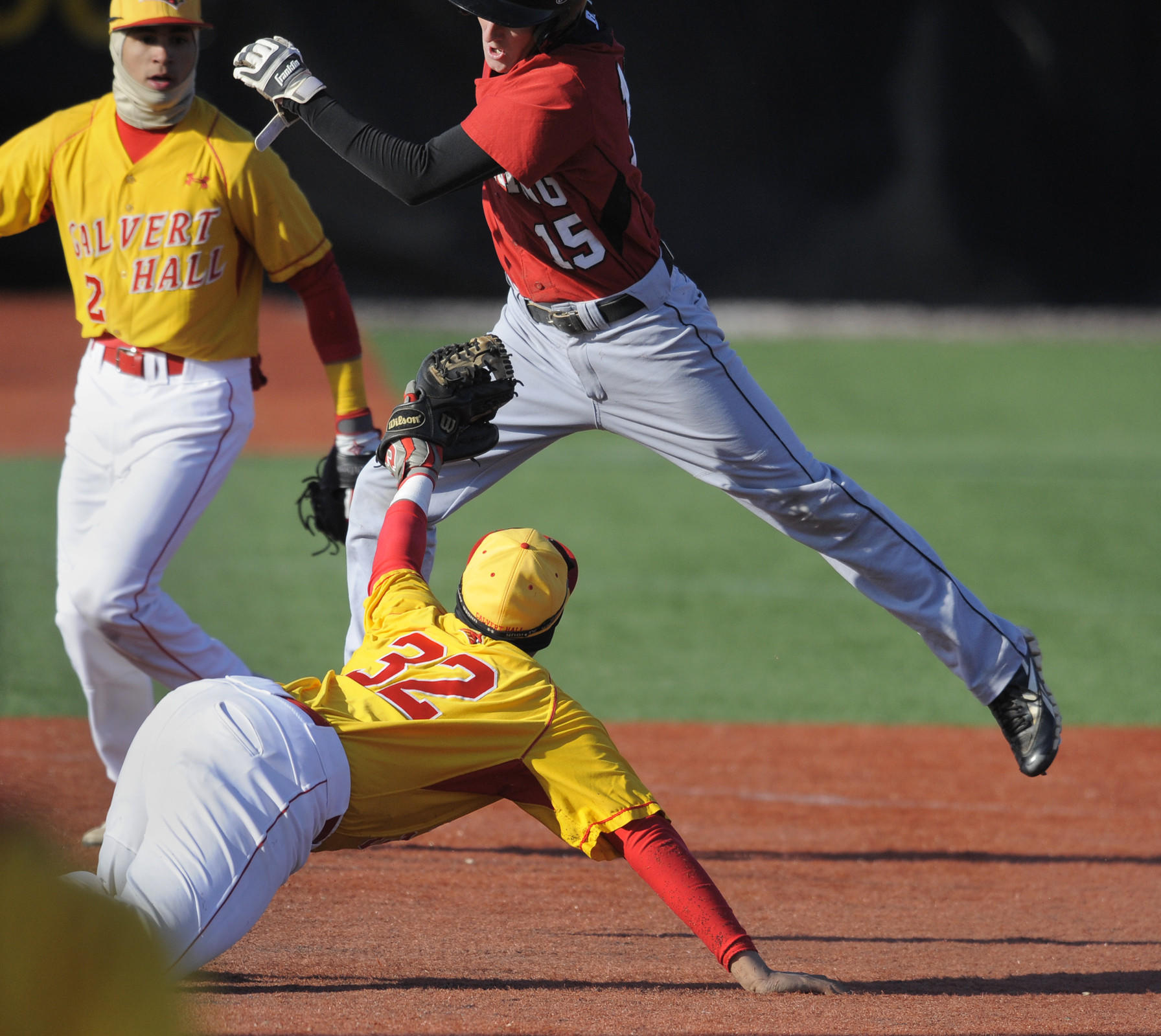Calvert Hall third baseman Brandon Dorsey is unable to tag out Spalding's Ryan Hunt as Hunt avoids the tag at third during the third inning.