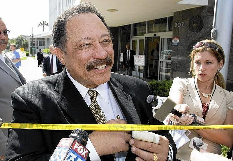 Judge Joe Brown, a television court judge, talks to media outside federal court in Ocala.