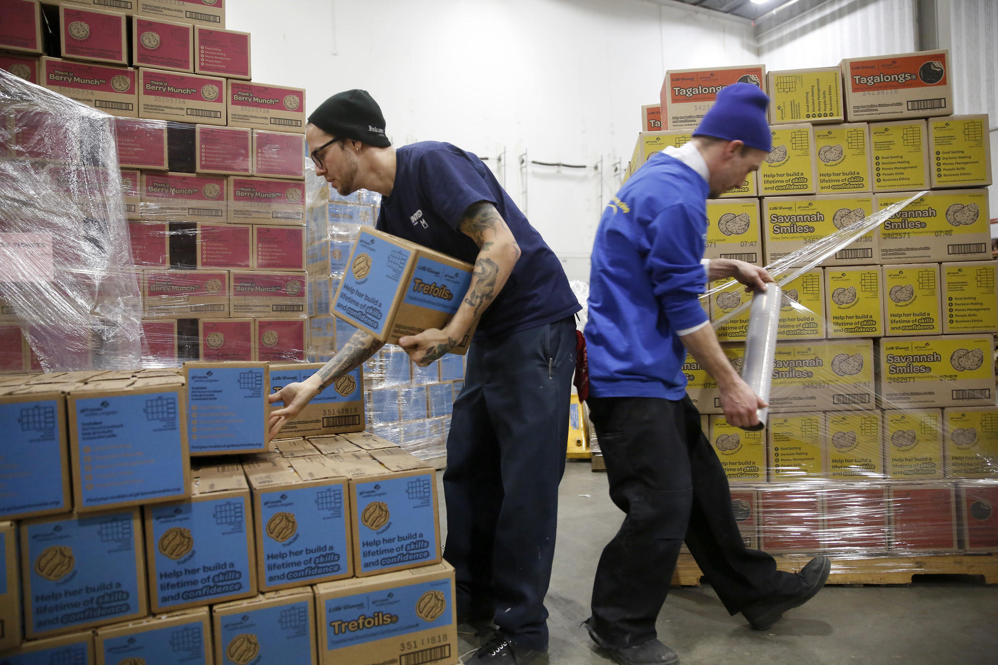 Workers fill pallets with cases of Girl Scout cookies to be distributed throughout the Chicagoland area. Each case holds between 12-16 boxes.
