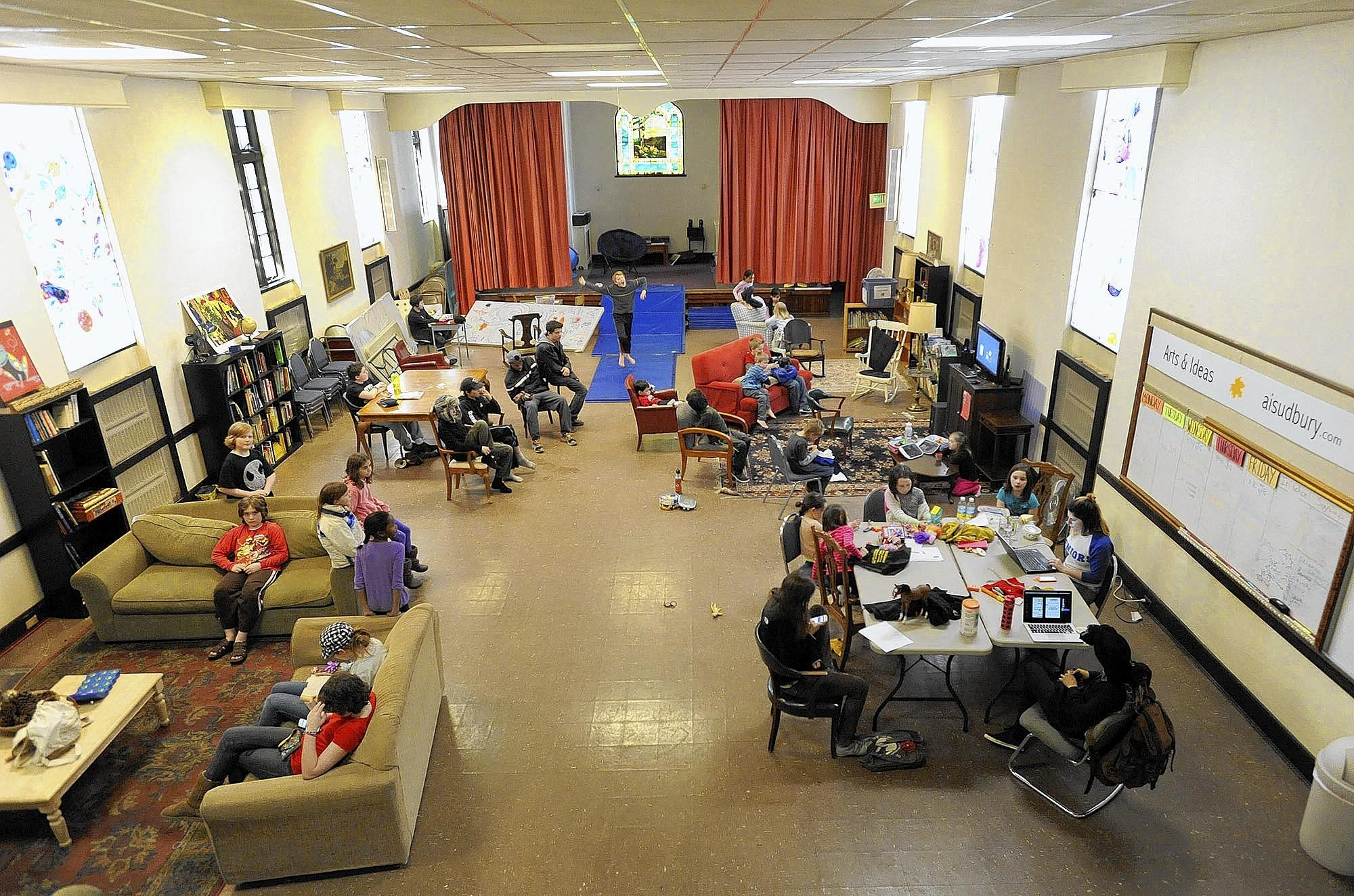 Arts and Ideas Sudbury School students gather in the school's Great Room on campus at the former St. John's Episcopal Church building in Mount Washington.