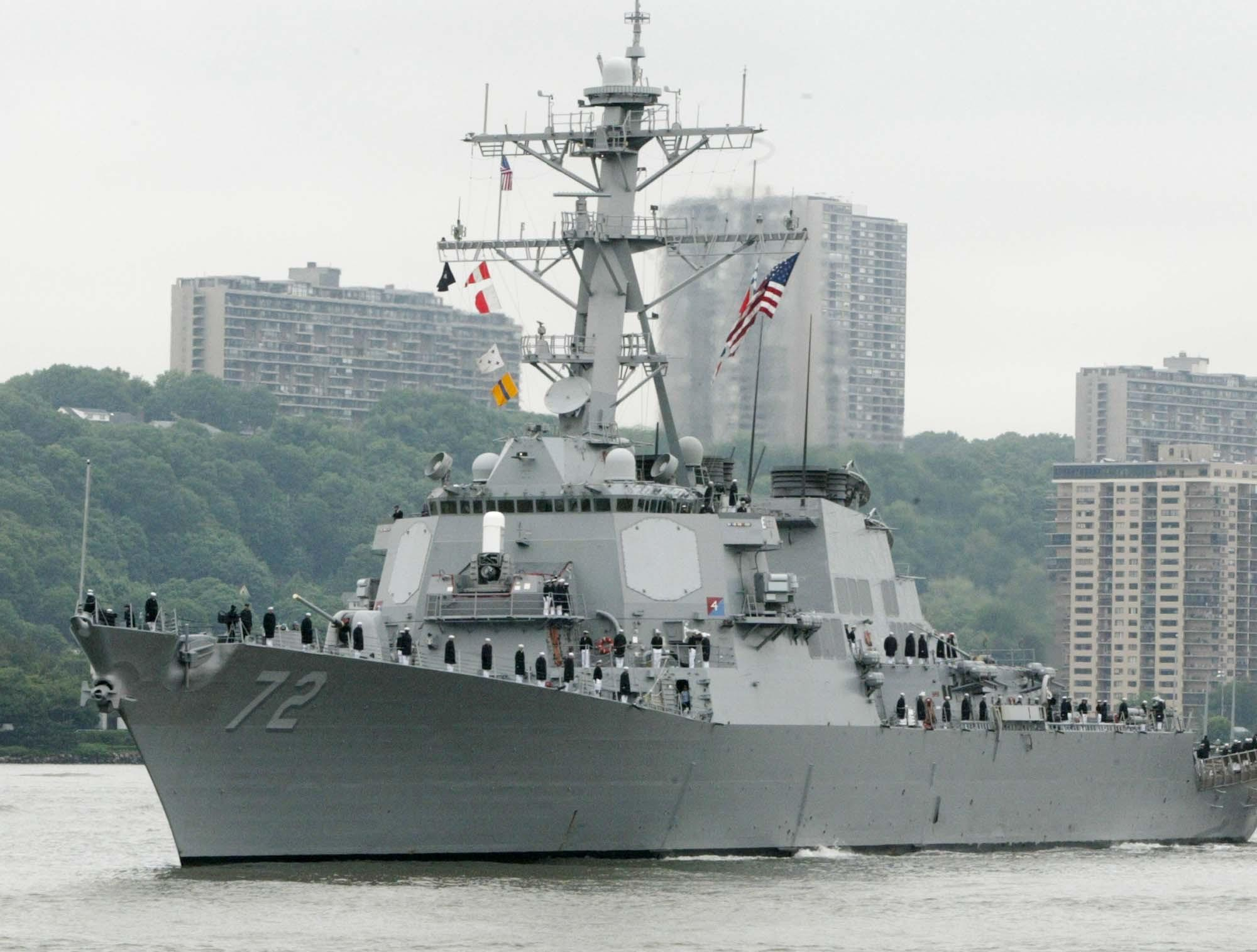 In this May 26, 2004 file photo, the USS Mahan, a guided-missile destroyer, moves up the Hudson River in New York during Fleet Week. A sailor was fatally shot aboard the USS Mahan at Naval Station Norfolk late Monday, March 24, 2014, and security forces killed a male civilian suspect, base spokeswoman Terri Davis said.
