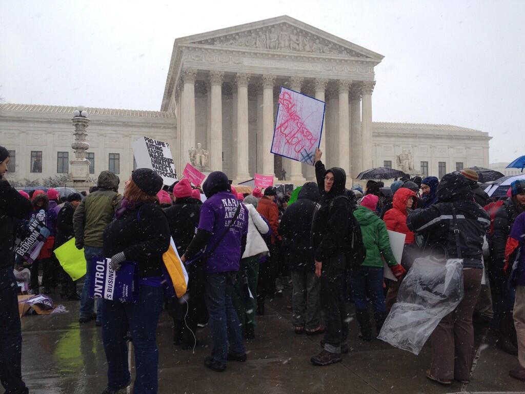 Protesters rally outside the U.S. Supreme Court, where arguments on contraception coverage are being heard.