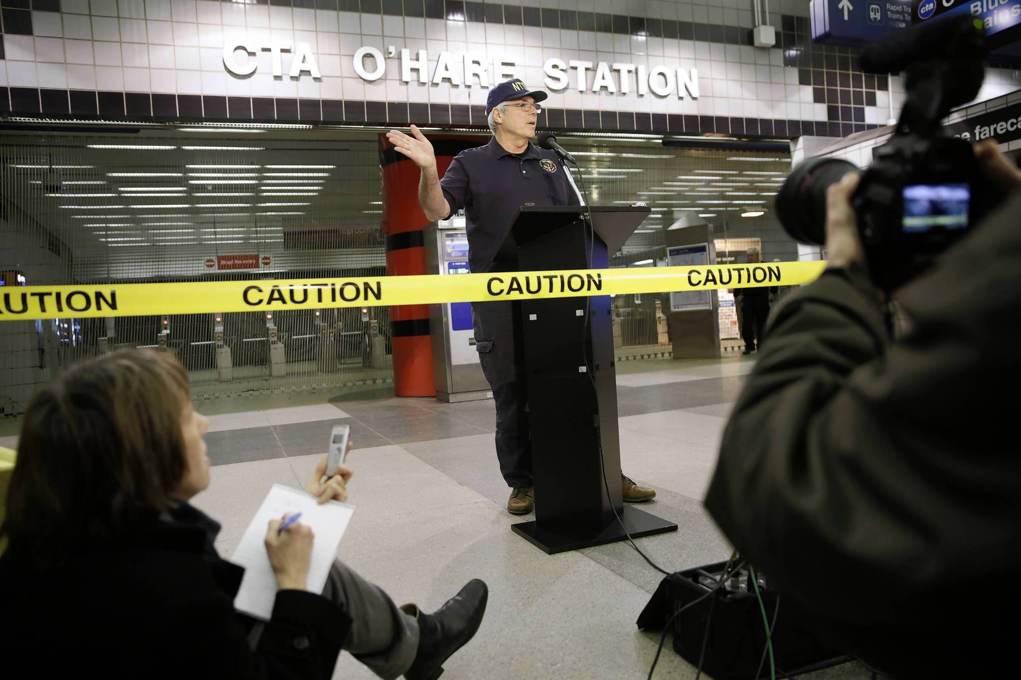 NTSB Investigator-in-Charge Ted Turpin updates reporters at the O'Hare CTA Blue Line Station on the train derailment.