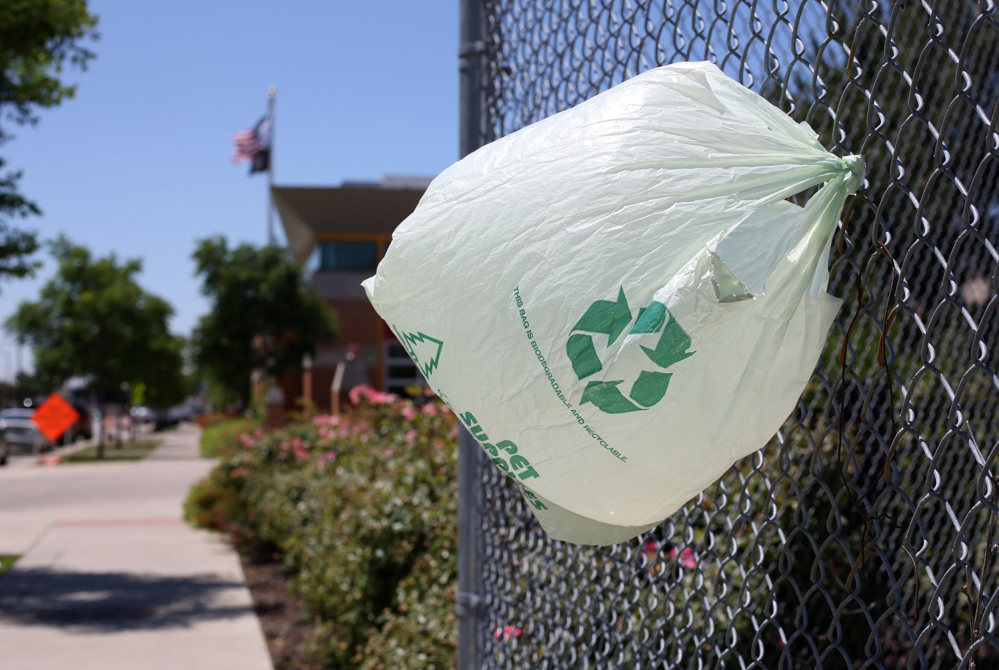 A Plastic bag hangs flapping from fence on Blue Island Avenue, Tuesday June 5, 2012.