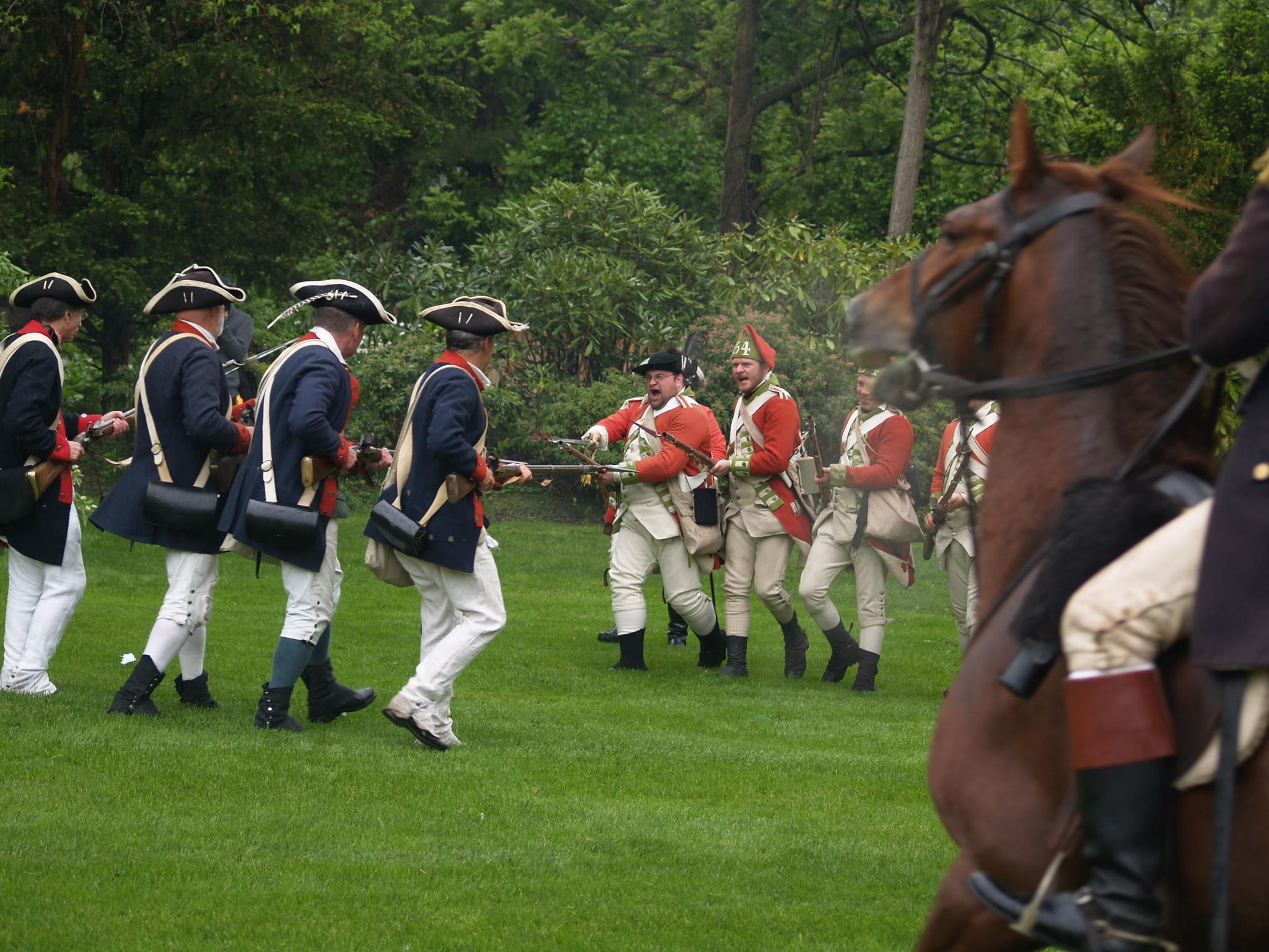 Continental and British soldiers skirmish at Revolutionary War Encampment at Webb-Deane-Stevens Museum.