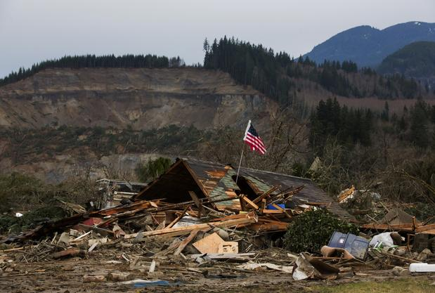 The remains of a home destroyed by a mudslide near Oso, Wash., on Saturday.