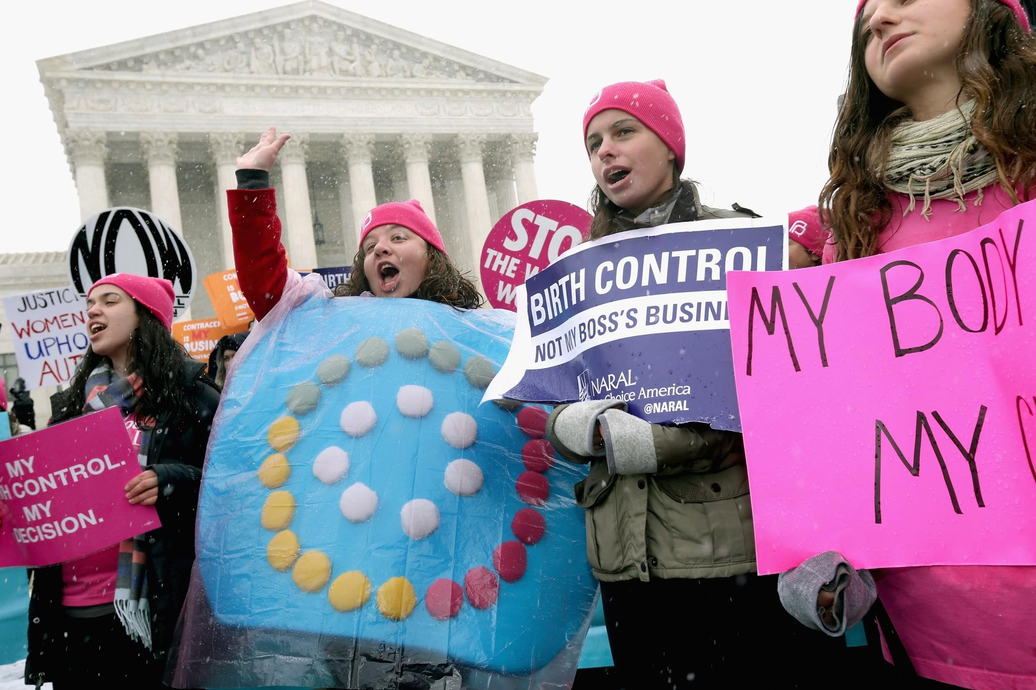 Demonstrators rally outside of the U.S. Supreme Court during oral arguments in Sebelius vs. Hobby Lobby on Tuesday in Washington.