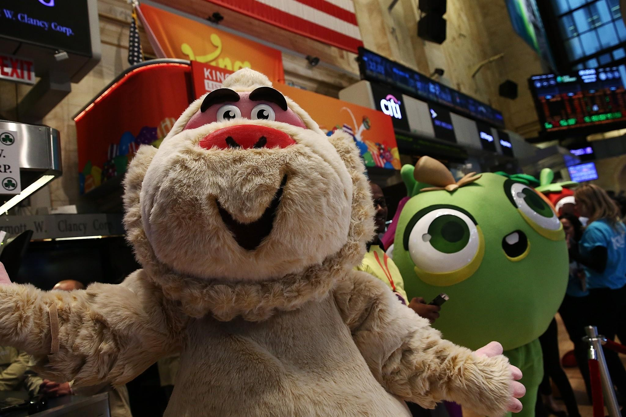 Characters from games made by King Digital Entertainment, maker of the popular Candy Crush game, roamed the floor of the New York Stock Exchange on Wednesday as the company made its Wall Street debut.