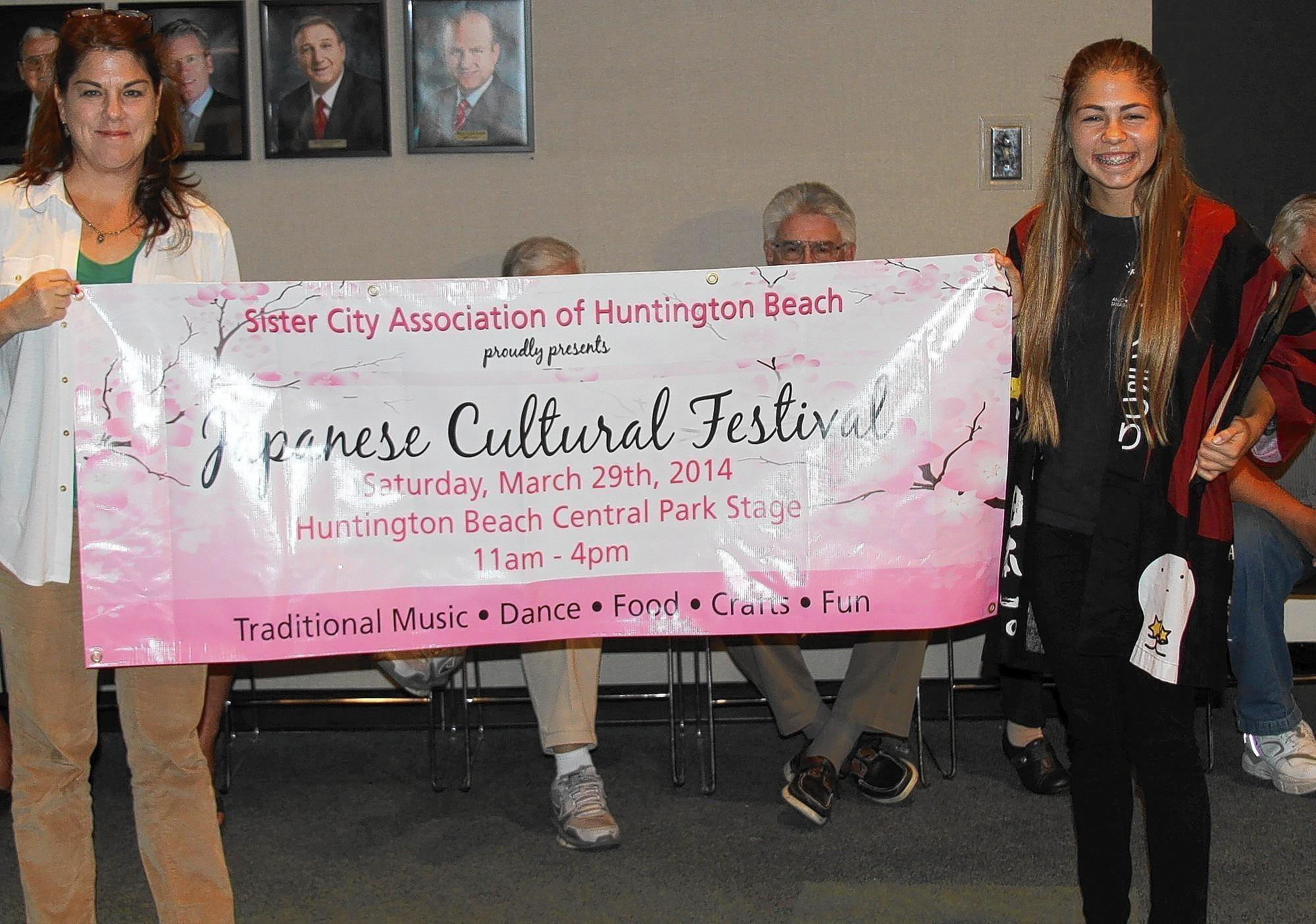 Natalie Anzivino, at right, is seen with her mom, Maureen, at a recent City Council meeting presenting a banner for the Festival she initiated.