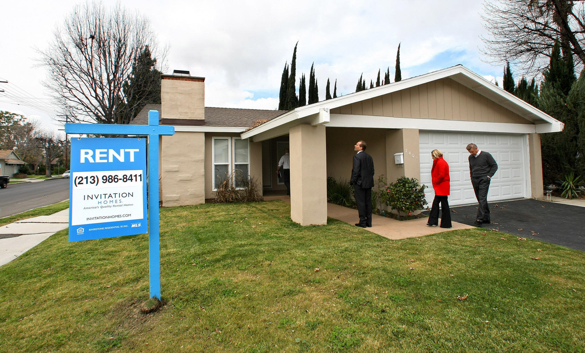 Officials From Invitation Homes Tour One Of Its Homes In Canoga Park.