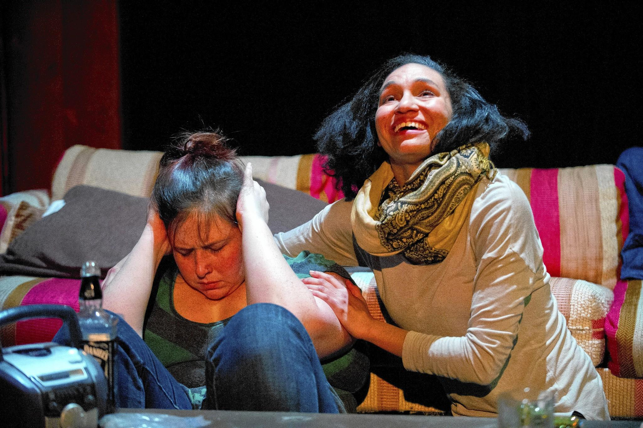 "At left, Anima (Katie Hileman) is visited by Mary-Androgyne (Samantha Nelson) during rehearsal for Interrobang Theatre Company's debut production, ""Scab."""