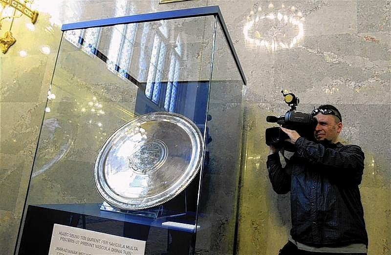 cameraman films one of the pieces of the Sevso treasure displayed at the Hungarian parliament in Budapest March 26, 2014.