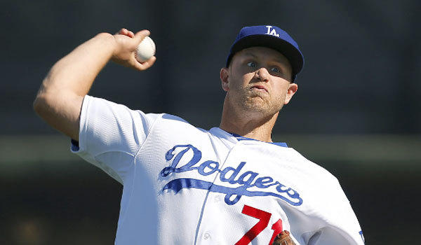 Former Dodgers pitcher Seth Rosin was claimed off waivers Wednesday by the Texas Rangers.