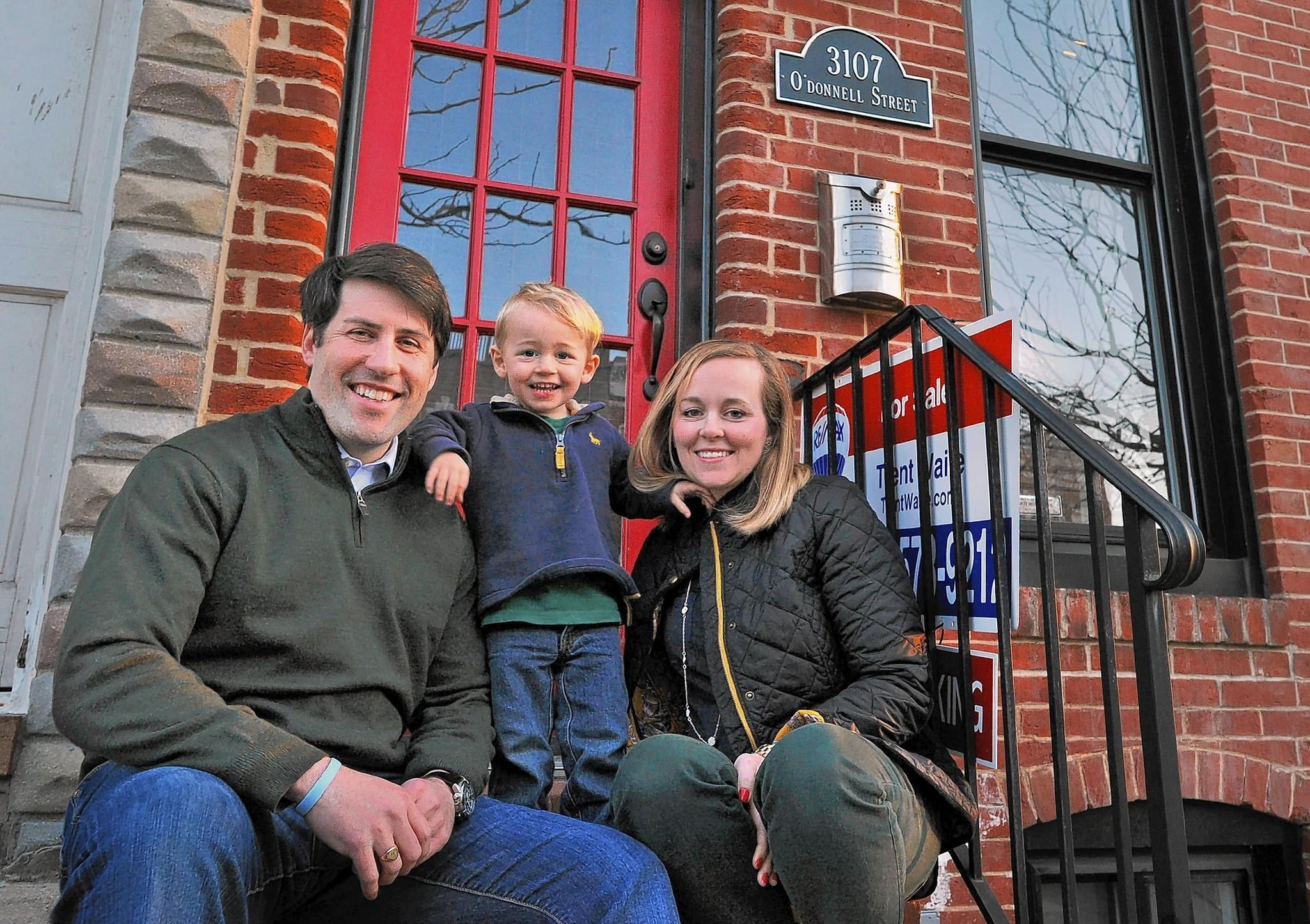 Jake and Stephanie Martin, with their son Max, 2 1/2, at their O'Donnell Street rowhouse in Canton, which sold in three days. Low inventory helped them to sell, but made it harder to find a new home. Through a friend, they found a larger house in Homeland that never went on the market.