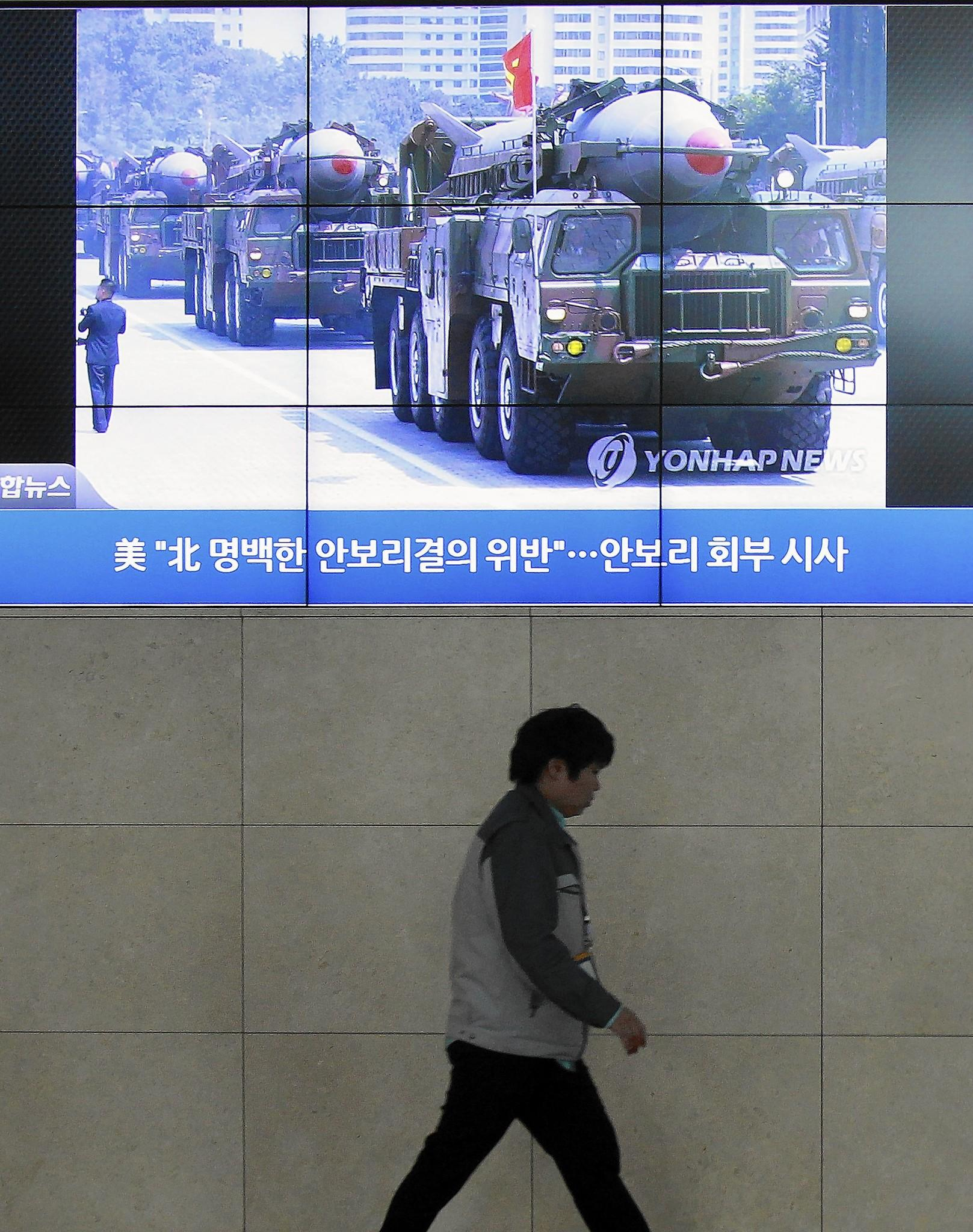 A giant screen in Seoul shows file footage of North Korean missiles in a military parade on a TV news program. North Korea test-launched two medium-range ballistic missiles Wednesday.