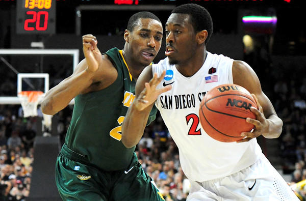 San Diego State guard Xavier Thames drives against North Dakota State guard Kory Brown in third-round game of the NCAA tournament on Saturday in Spokane.