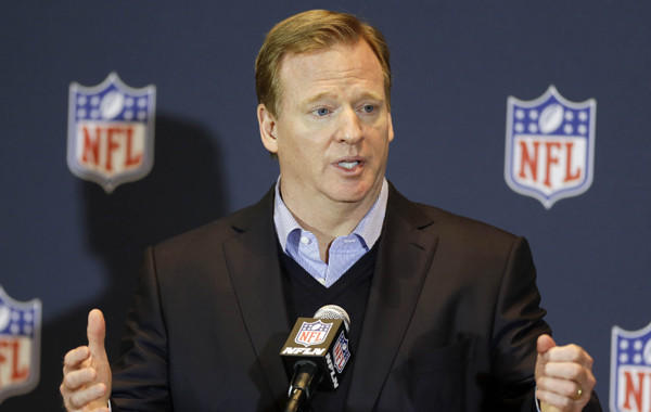 "NFL Commissioner Roger Goodell answers questions during a news conference at the conclusion of the league's annual meeting Wednesday in Orlando, Fla. Goodell says he thinks ""there's a tremendous amount of interest"" in expanding the NFL postseason."