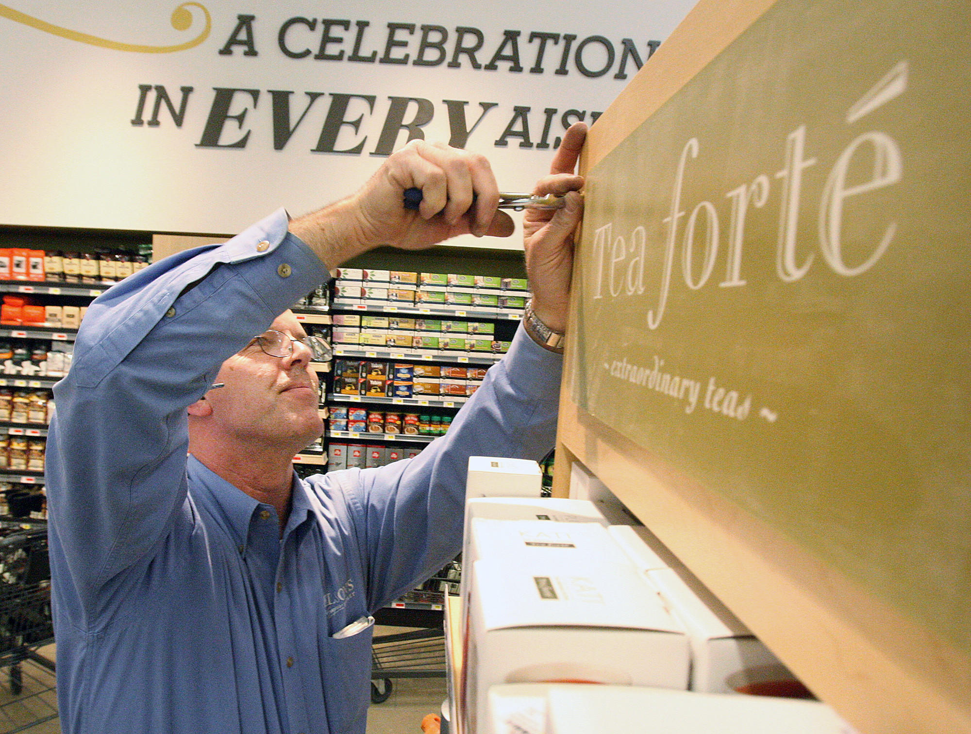 Merchandising manager Chris Kelley, who has worked with Gelson's for 29 years, fixes up the tea display at the store's new location in La Cañada Flintridge on Monday, March 24, 2014. The store will have its grand opening on March 27 at 9:00 A.M.