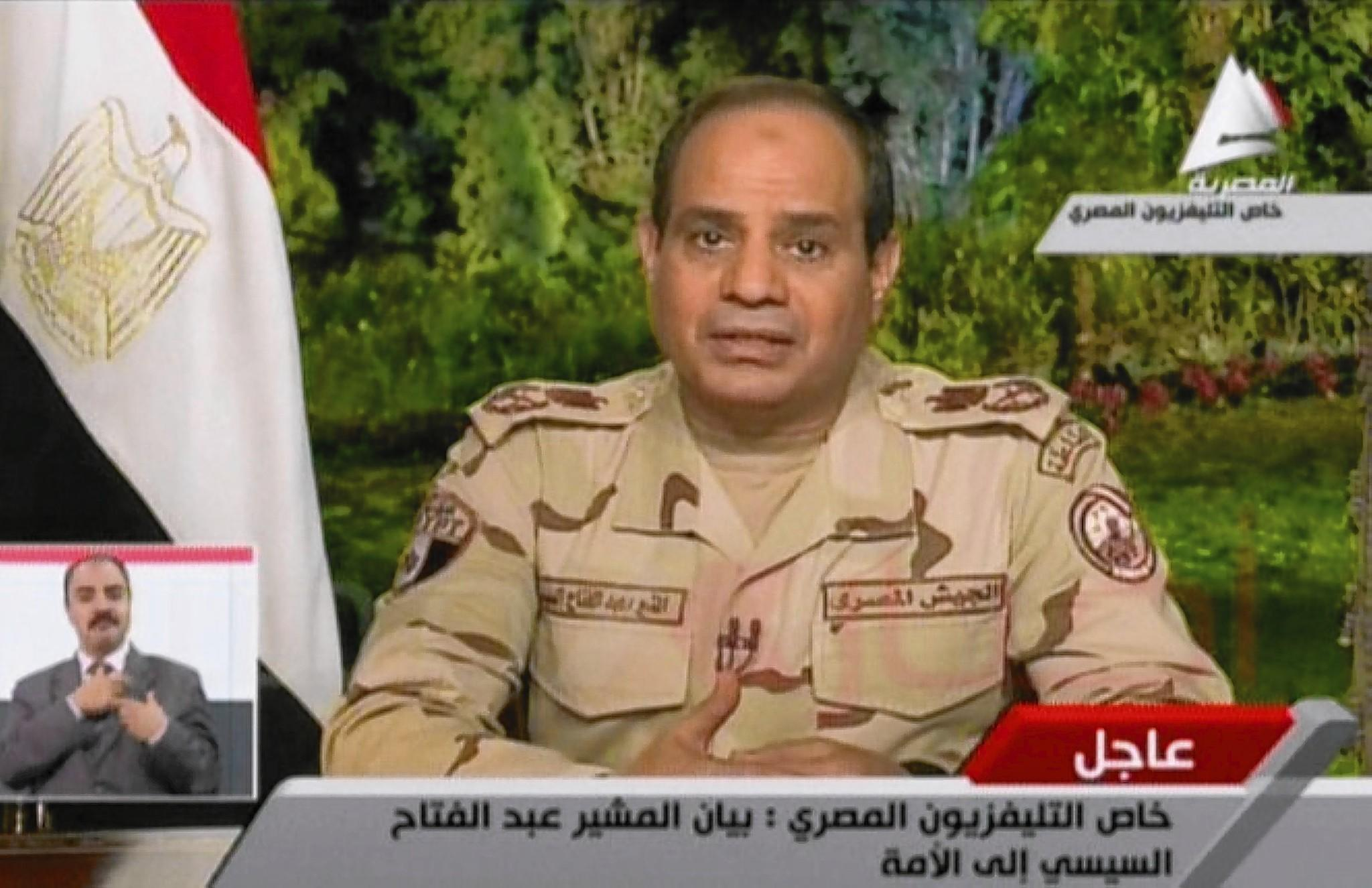 In Cairo, Abdel Fattah Sisi announces his resignation from his military position so he can run in the upcoming Egyptian presidential election, in an image taken from television.