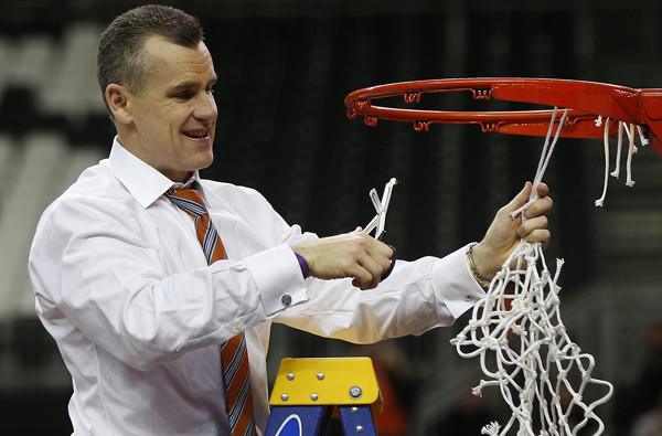 Florida Coach Billy Donovan takes his turn at cutting down the net after the Gators defeated the Kentucky Wildcats for the Southeastern Conference tournament title.
