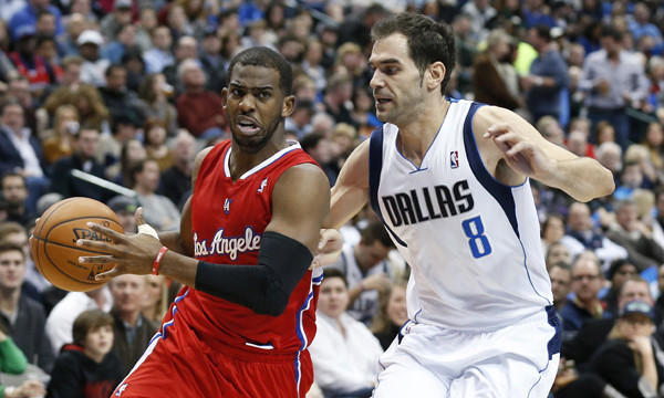 Clippers guard Chris Paul, left, drives around Dallas Mavericks guard Jose Calderon during the Clippers' 119-112 win Jan. 3.
