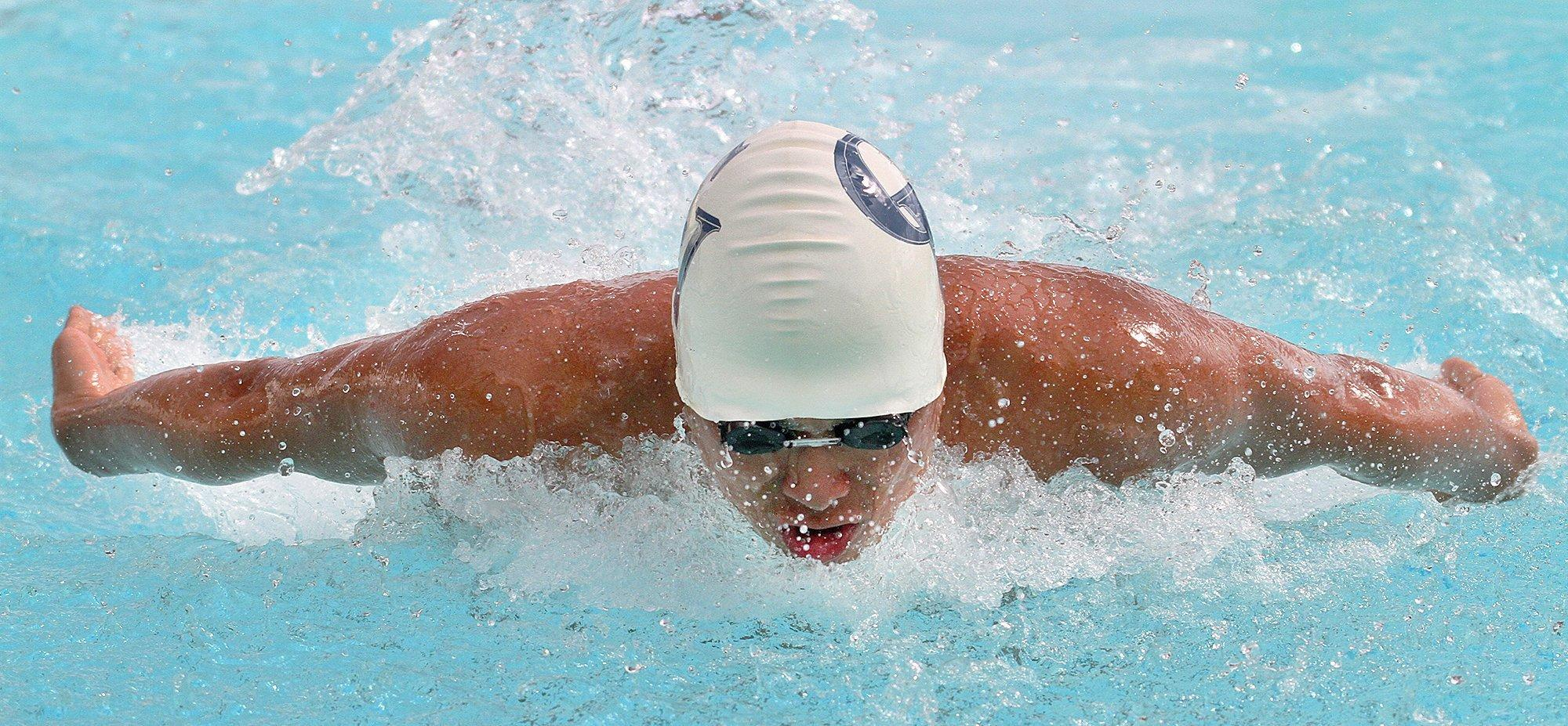Crescenta Valley High's Edward Yi swims the butterfly leg of the 200 medley relay en route to four victories in a Pacific League swim meet between Crescenta Valley and Glendale at Glendale on Wednesday. (Tim Berger/Staff Photographer)