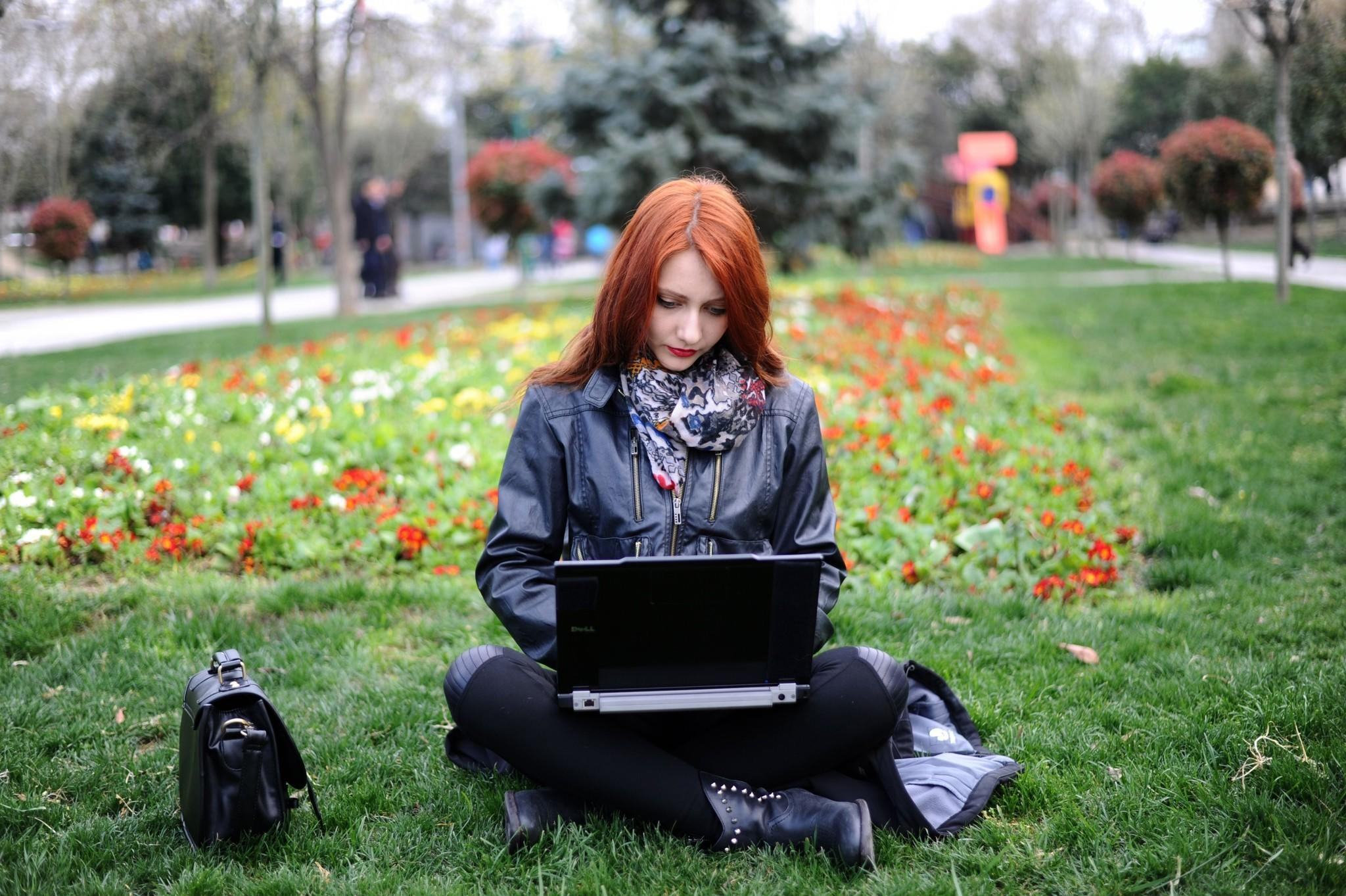 "A woman uses her laptop Wednesday in Istanbul, Turkey. On Thursday, a check of YouTube in Istanbul brought up the message: ""Access has been blocked by the Turkish Telecommunications Authority."""