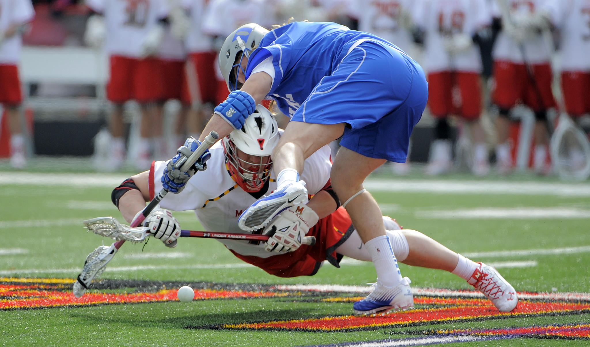 Charlie Raffa of Maryland, bottom, and Brendan Fowler of Duke vie for the ball during a faceoff in the third quarter March 1. Maryland won the game 10-6.
