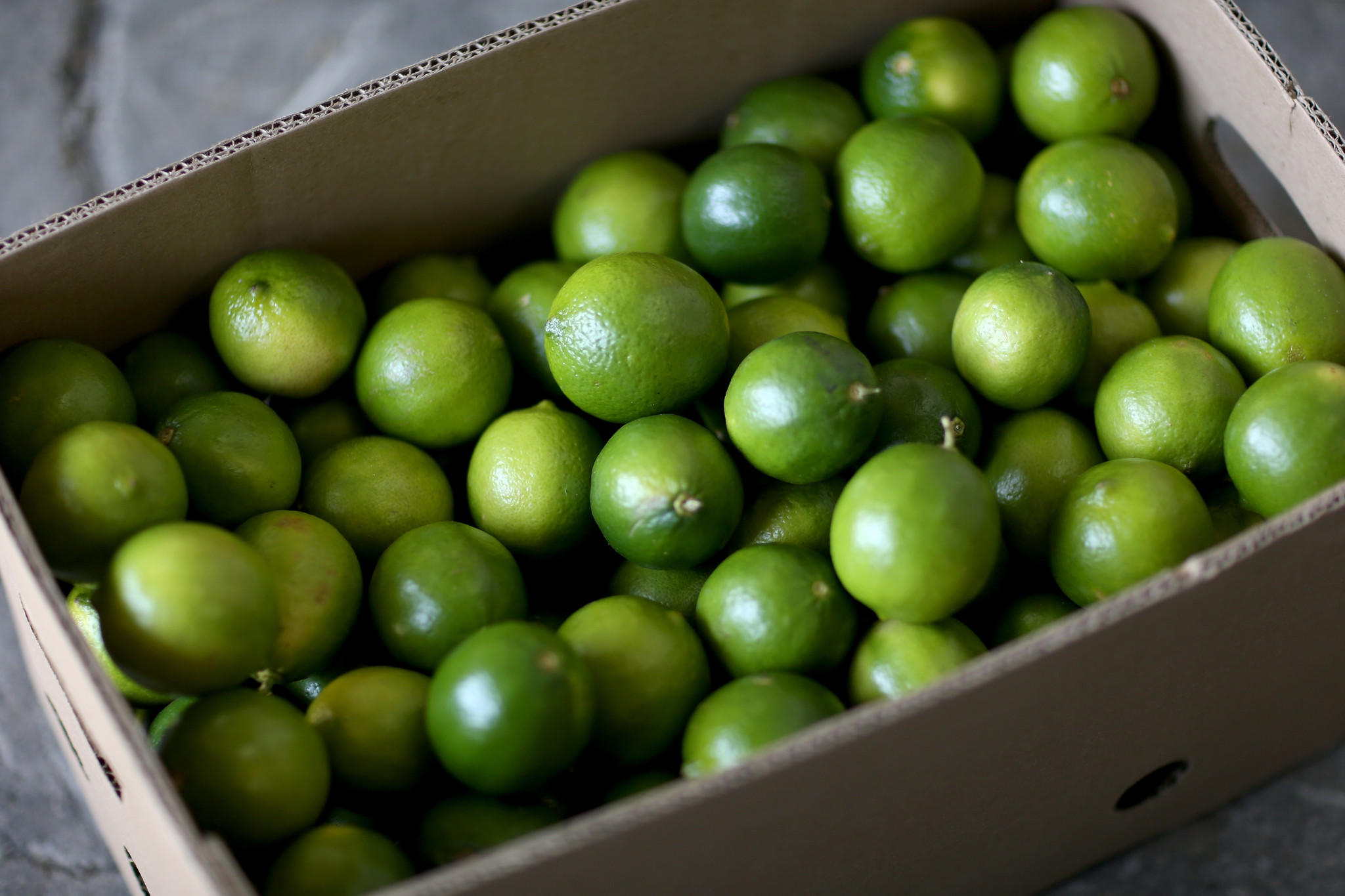 Limes that have been imported from Columbia are boxed at Marco produce on March 26 in Miami, Florida.