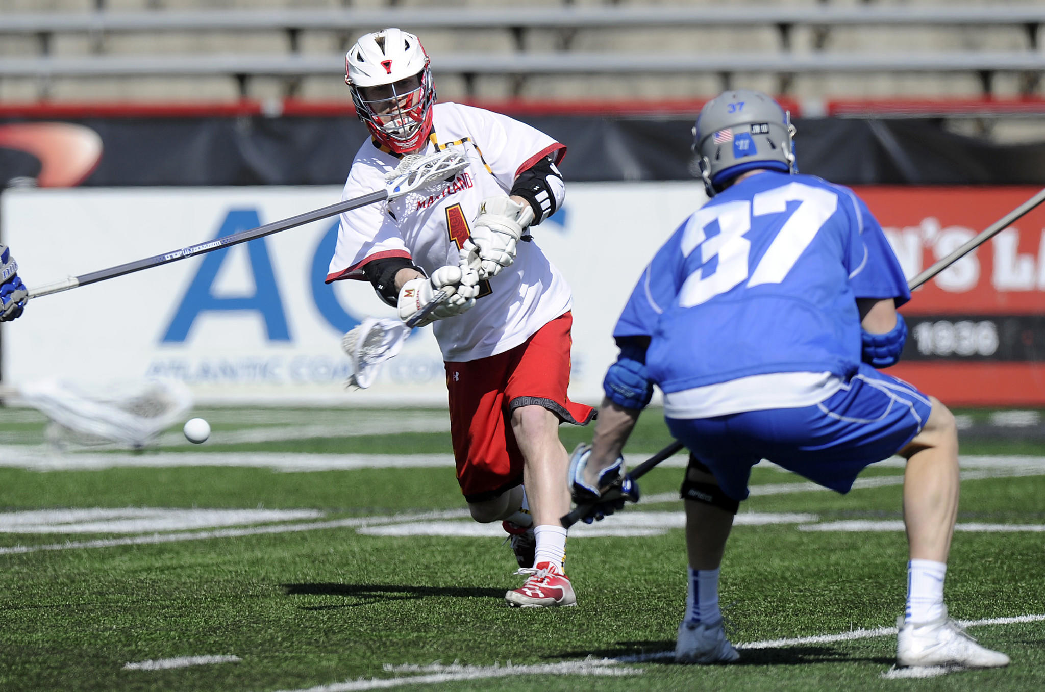 Maryland midfielder Mike Chanenchuk fires a low shot in front of defenseman Casey Carroll in a 10-6 Terps win on March 1 in College Park.