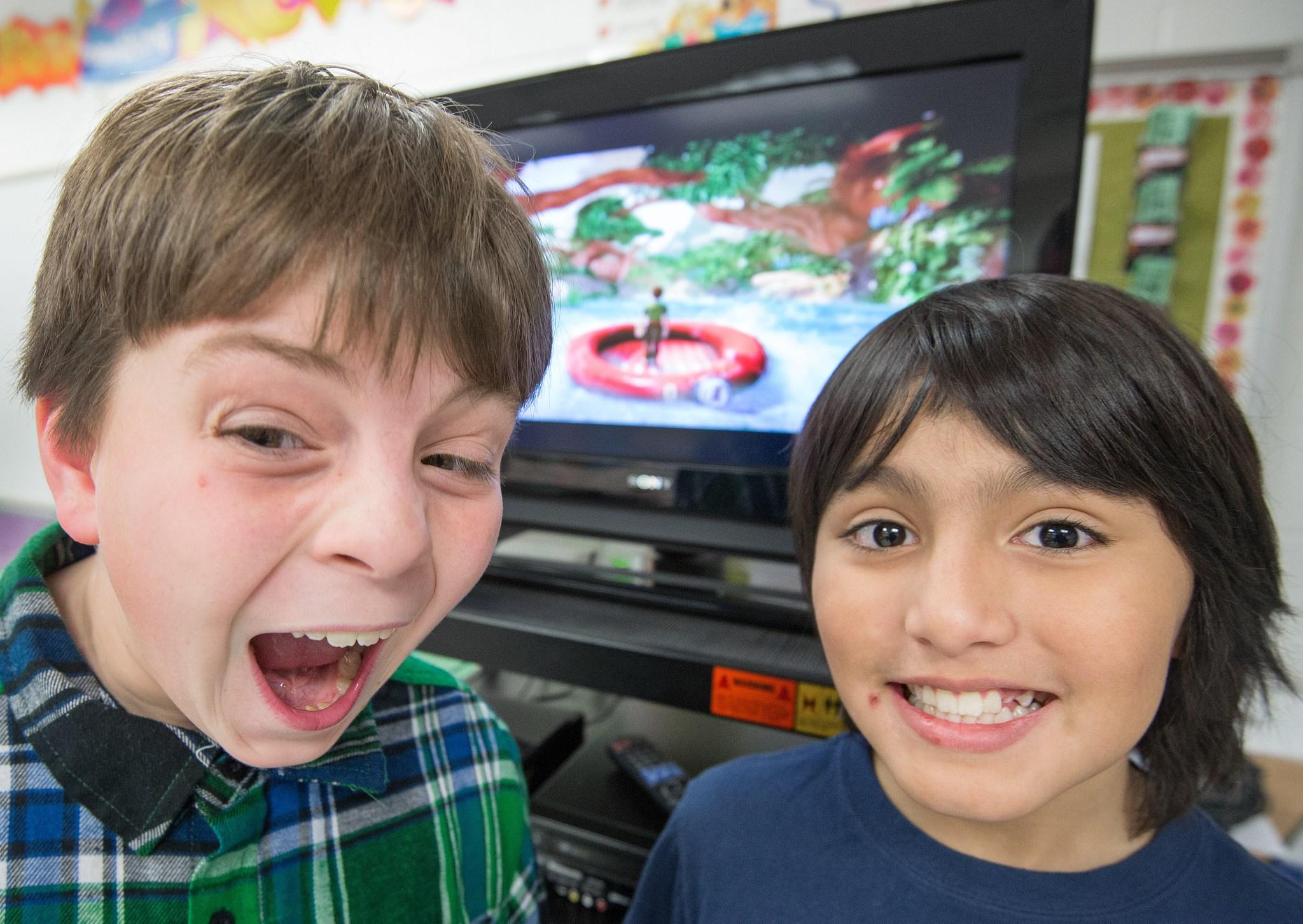 Sawyer Whitely(L) and Michael Mendoza, who are autistic, pose for a photo while playing selected games on a Microsoft X-box Kinect on February 21, at Steuart W. Weller Elementary School in Ashburn, Virginia. Experts children with autism can benefit from playing some computer games such as Kinect, that help with coordination, body awareness and cooperation, all challenges for kids on the autism spectrum.