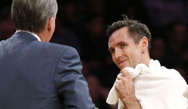 Lakers point guard Steve Nash, shown talking to Coach Mike D'Antoni, will miss at least the next two games.