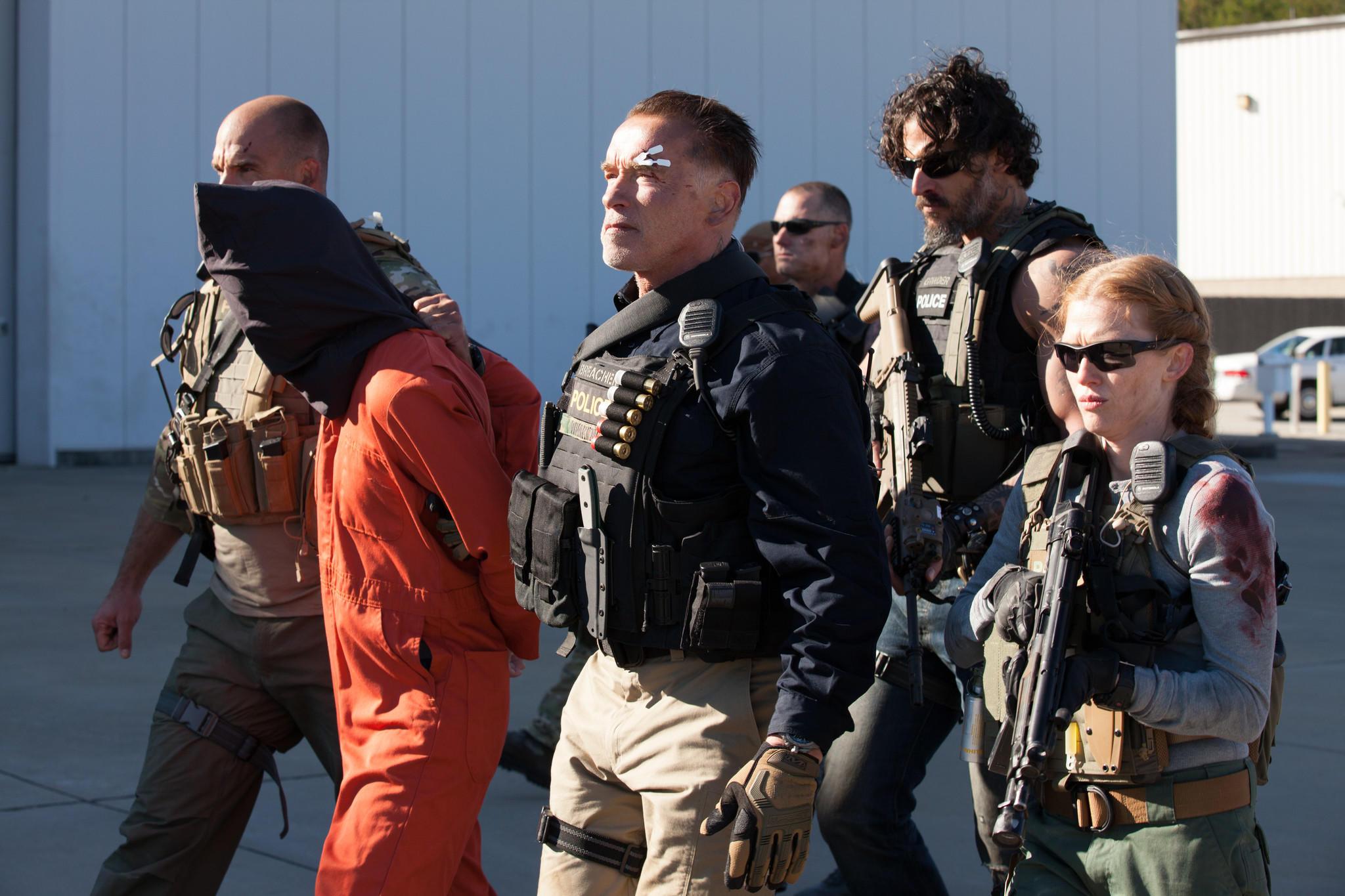 """Arnold Schwarzenegger as Breacher, Joe Manganiello as Grinder, and Mireille Enos as Lizzy in """"Sabotage."""""""