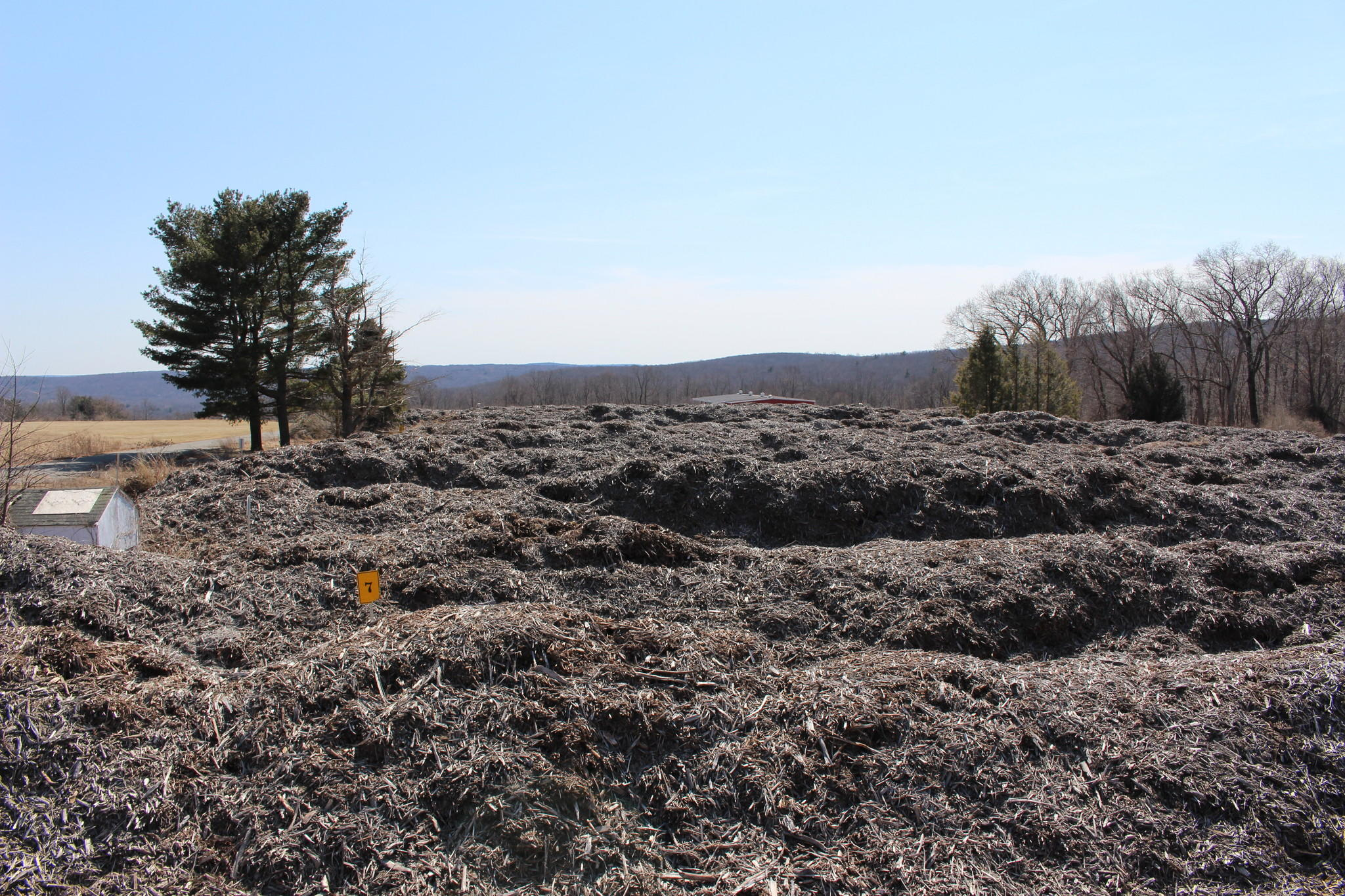 Almost 30,000 cubic yards of debris from 2011's Halloween nor'easter is spread in 25 rows at the former Arbor Acres Farm. The material will be hauled away later this spring.