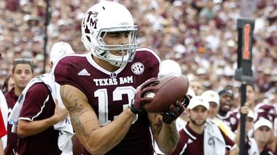 "Ravens scout wide receiver Mike Evans at ""Johnny Football&…"