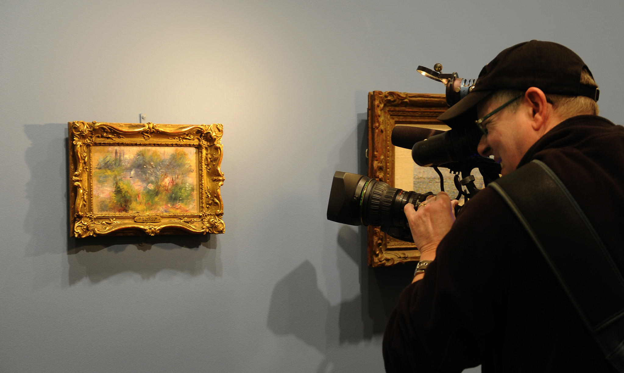 "A press photographer gets a closer look at ""On The Shore Of The Seine"" during a press preview at the Baltimore Museum of Art."