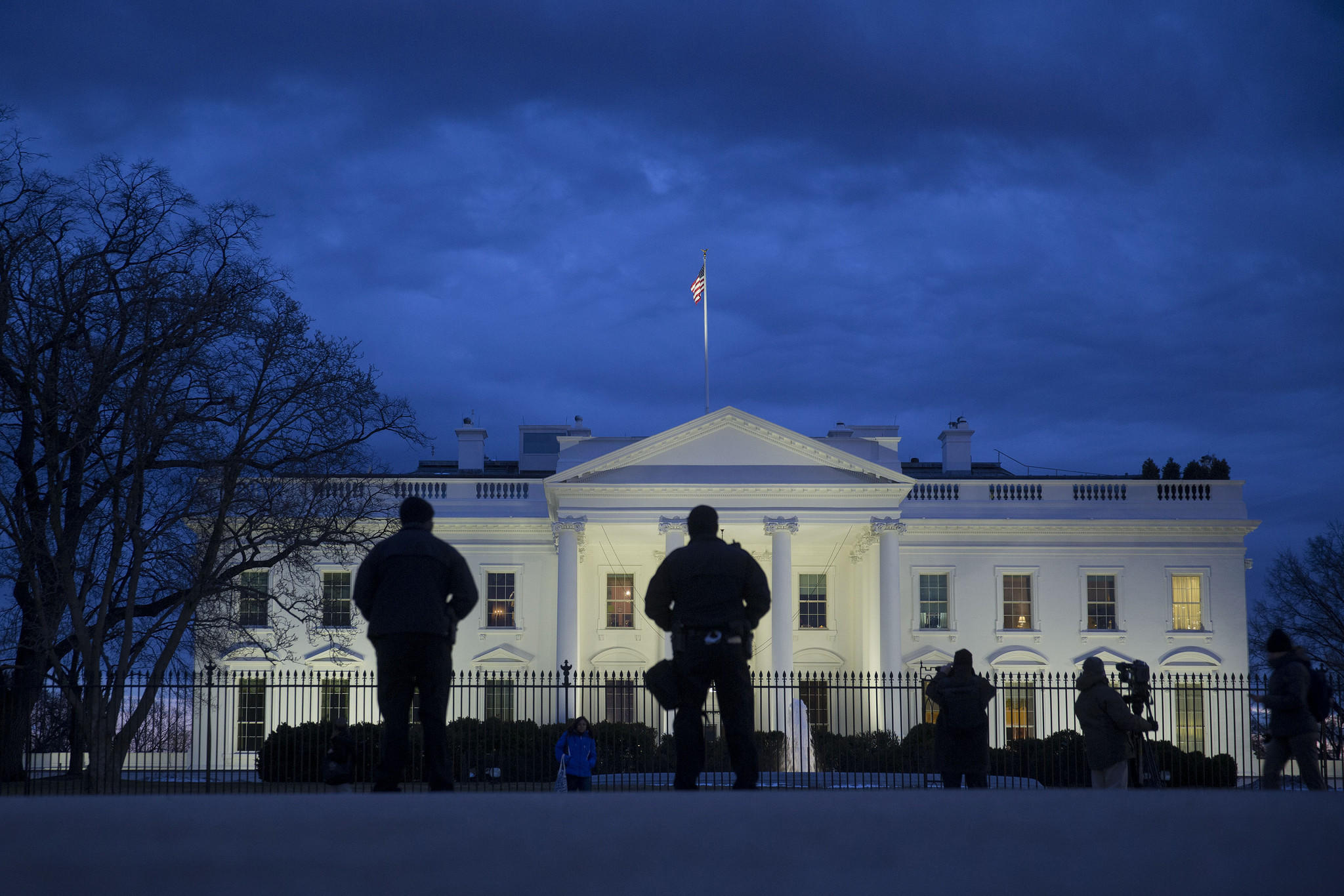 Secret Service officers stand in front of the White House in Washington, D.C.