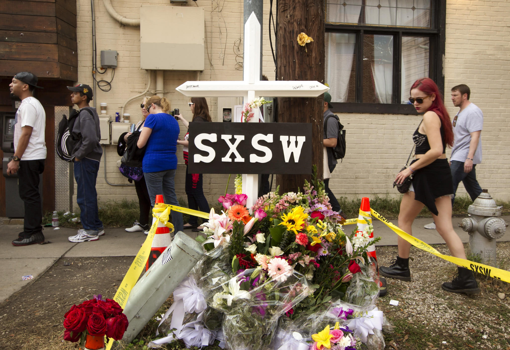 A cross and flowers were placed outside The Mohawk club in Austin, Texas, as a memorial to the people who died in the hit-and-run tragedy at SXSW.