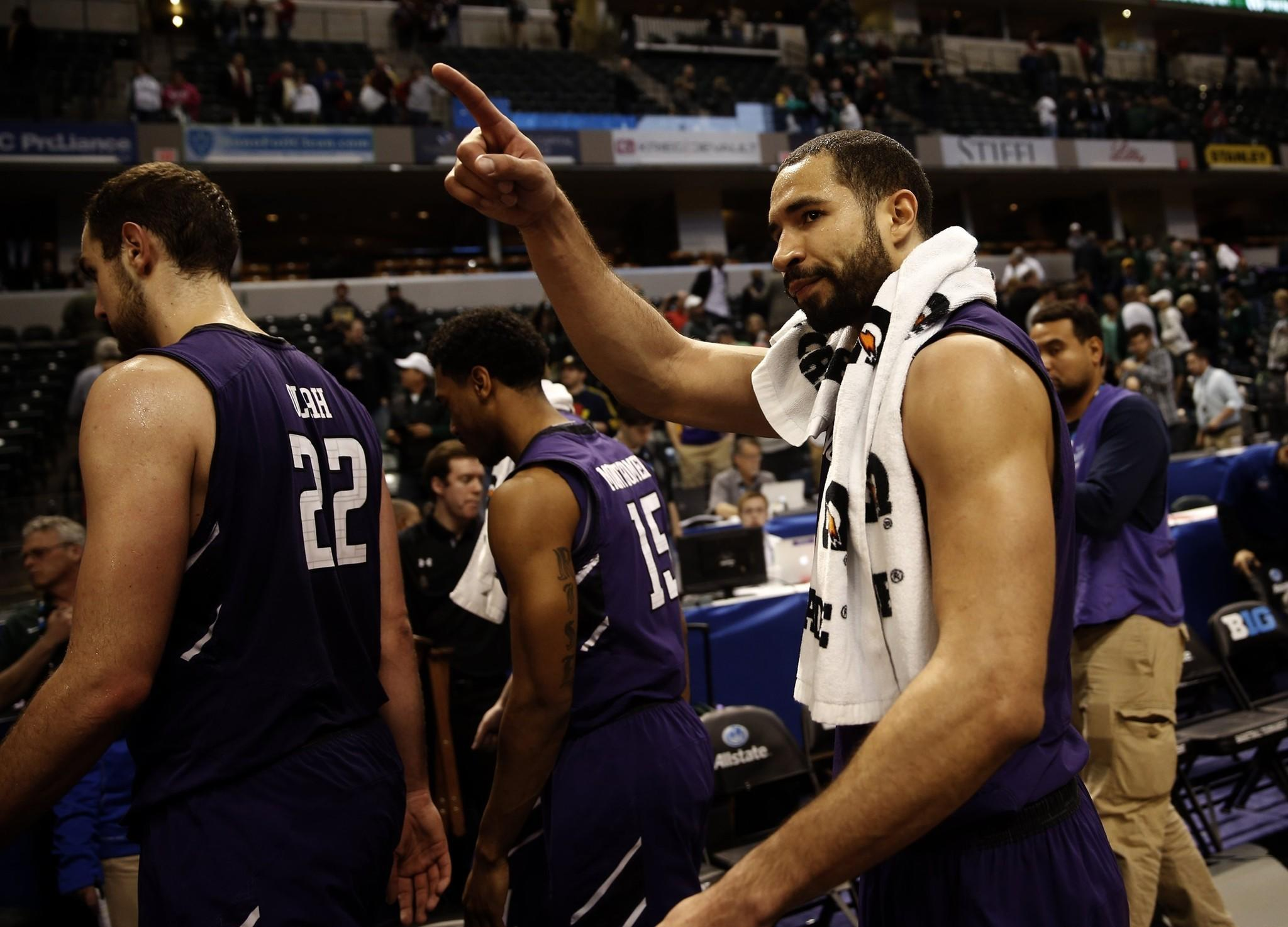 Northwestern's Drew Crawford leaves the court after the Wildcats' loss to Michigan State, 67-51, in the Big Ten tournament quarterfinals on March 14.