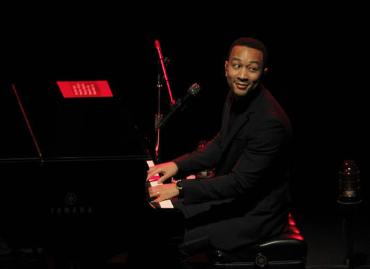 John Legend, the R&B singer whose recent work has trended away from civil rights-era soul to more personal, electronic meditations on relationships, oozes charm during his acoustic performance at Walt Disney Concert Hall in Los Angeles on March 26, 2014.