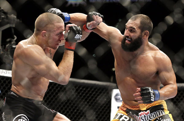 Georges St-Pierre, left, and Johny Hendricks exchange punches during their welterweight title fight at UFC 167 last year.