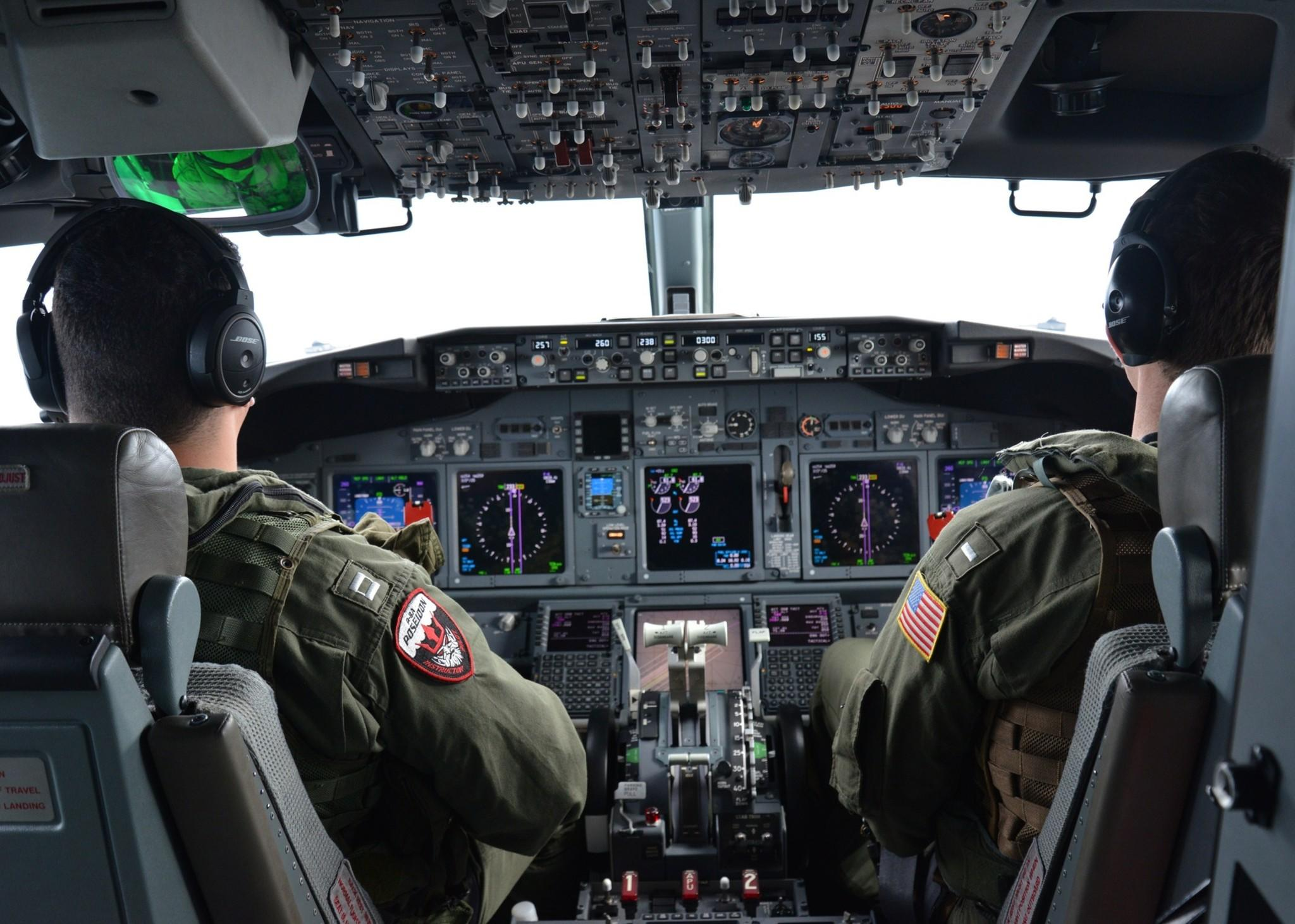 Lt. Clayton Hunt, left, and Lt. j.g. Nicholas Horton, U.S. naval aviators assigned to Patrol Squadron (VP) 16, pilot a P-8A Poseidon over the Indian Ocean during a mission to assist in the hunt for Malaysia Airlines Flight 370.
