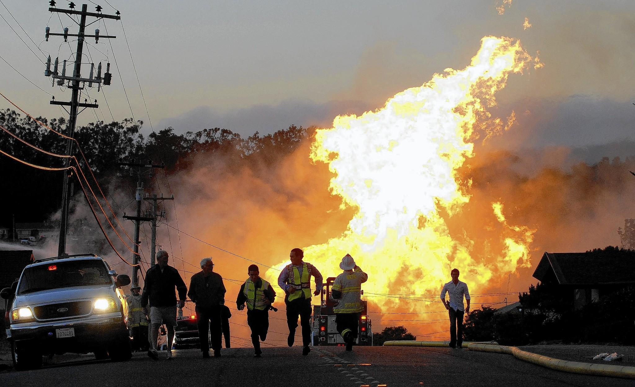 Flames billow in the hills above San Bruno, Calif., after a gas pipeline exploded in September 2010. Utility giant Pacific Gas & Electric Co. said Thursday it expects federal officials to bring criminal charges against the company in connection with the blast, which killed eight people and destroyed 38 homes.