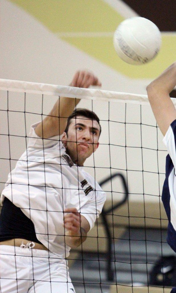 St. Francis High's Markar Agakanian connects on a kill attempt against Chaminade in a boys' volleyball match at St. Francis on Thursday. (Tim Berger/Staff Photographer)