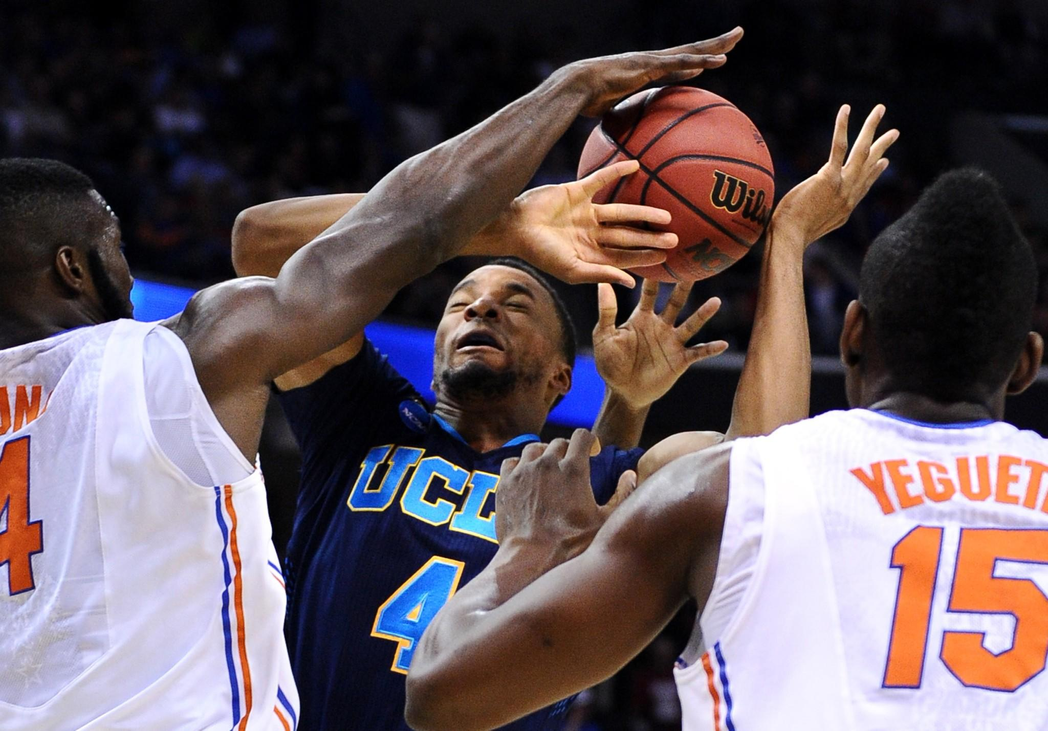 Bruins guard Norman Powell is fouled by Gators forward Patric Young on a shot in their NCAA tournament game.
